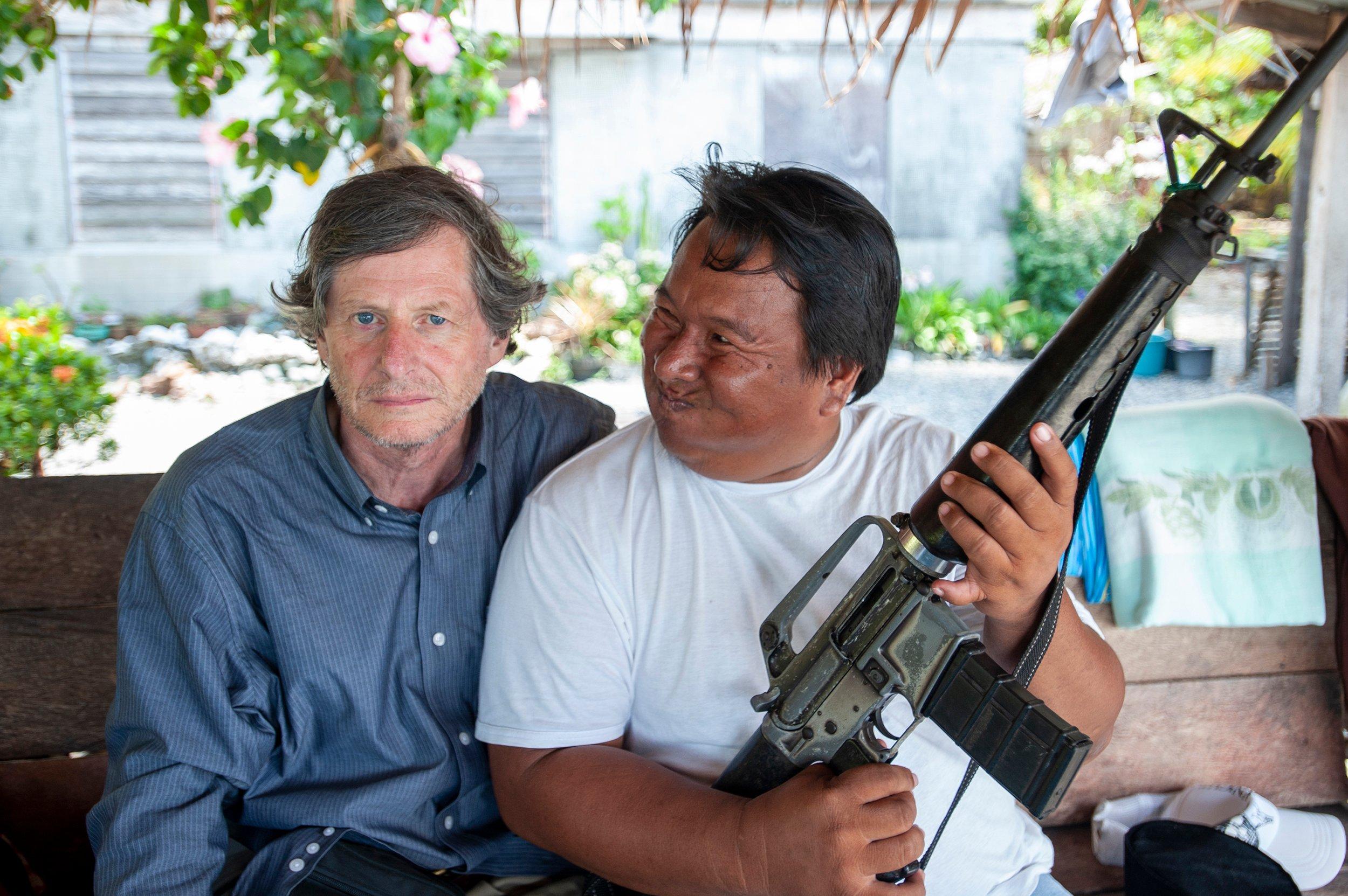 M.Coyne with rebel guard-PhilippinesMICHAELCOYNE©2008 - Do Not Reuse